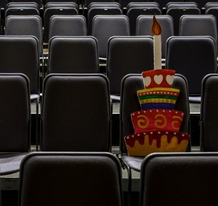 Cut out of a cake on theatre seats